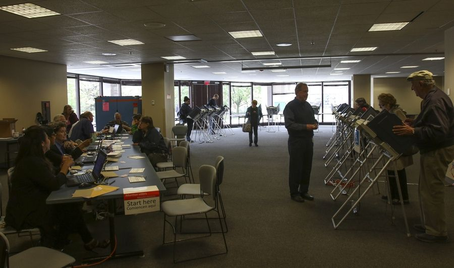 Voters cast their ballots Thursday for the Nov. 8 election at Naperville's city hall. Suburban election officials say early voting is running at a record-breaking clip.
