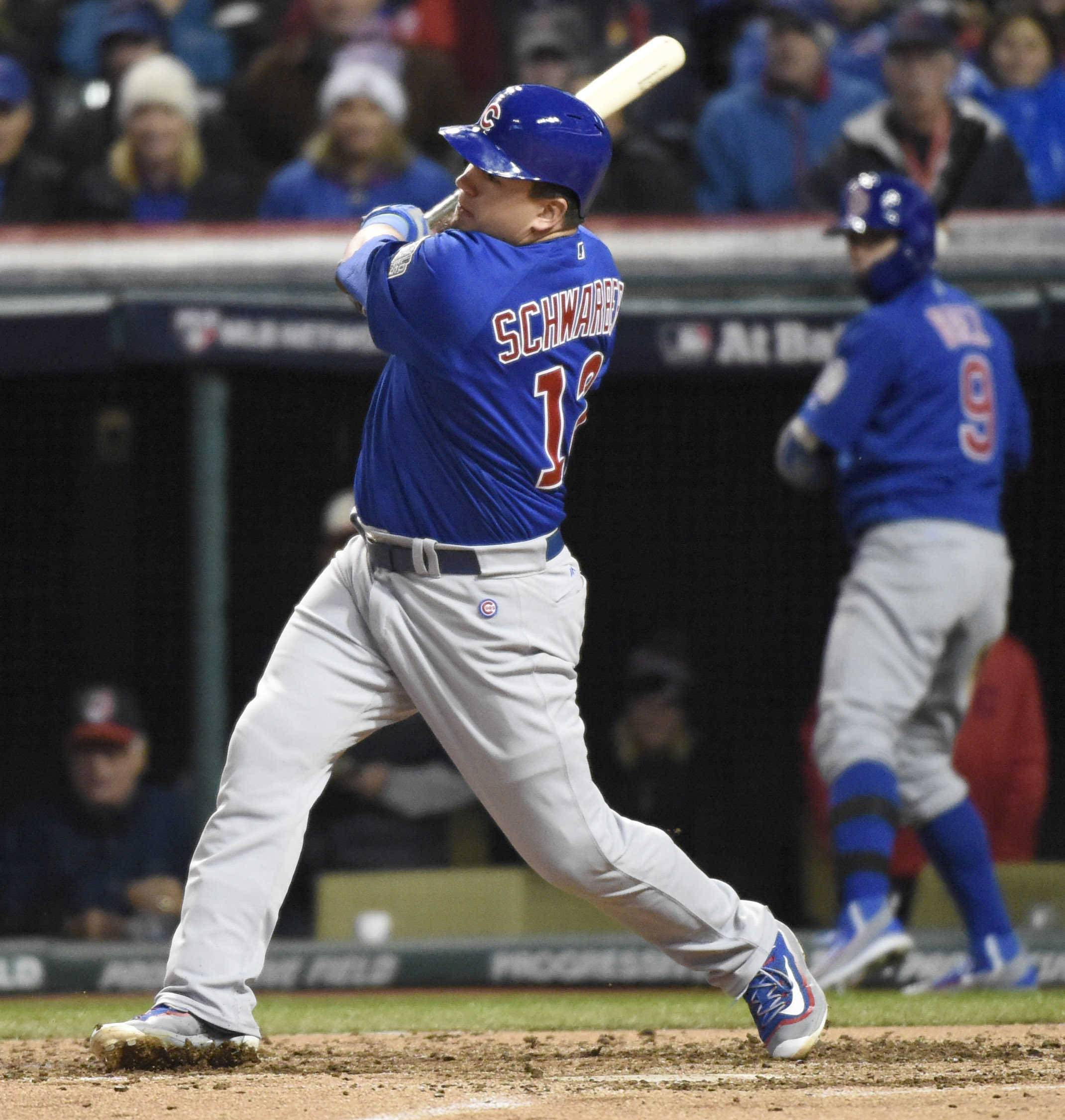 Chicago Cubs designated hitter Kyle Schwarber hits an RBI single in the third inning during Game 2 of the Major League Baseball World Series. Schwarber was able to play in the Series after recovering from full tears to the ACL and LCL in his left knee.