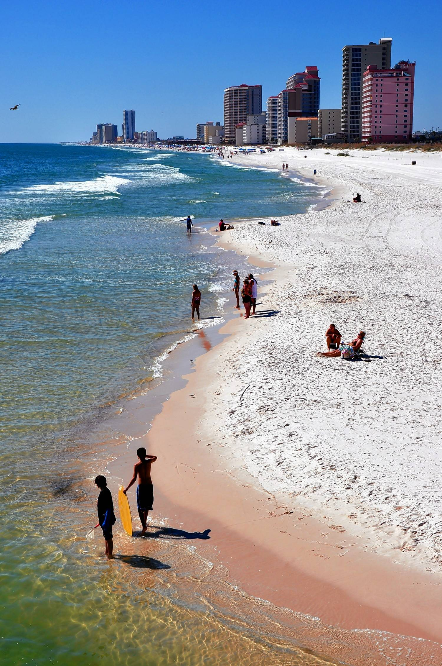 Vacationers gravitate to the 32 miles of white sand beaches on Alabama's Gulf Coast.