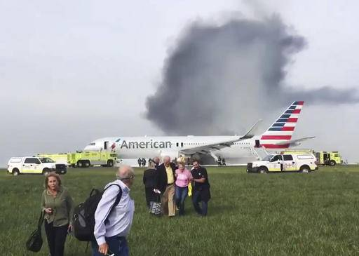 The Latest: Passenger: Heard explosion, then saw flames