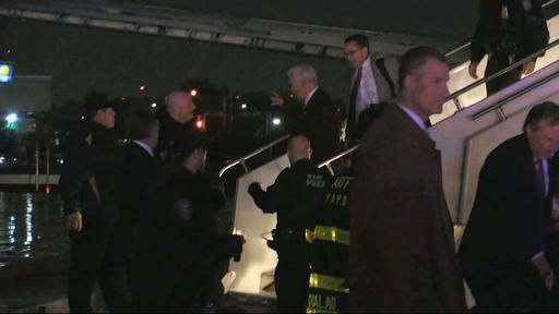 Republican vice presidential candidate Indiana Gov. Mike Pence walks down the steps of his campaign plane at New York's LaGuardia Airport after it slide off the runway while landing on Thursday, Oct. 27, 2016. (TV Network Pool via AP)