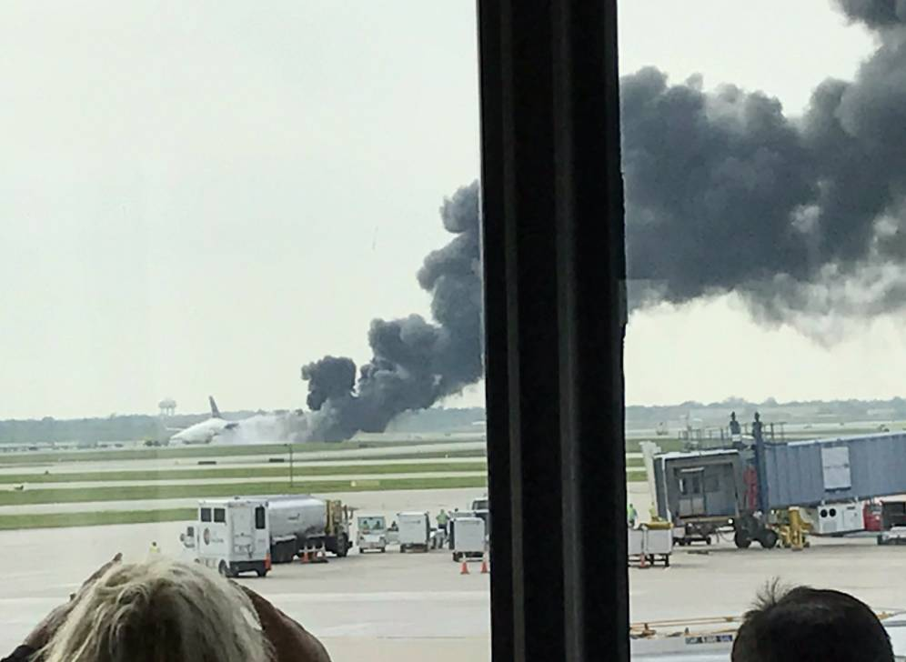 An American Airlines plane on fire at O'Hare International Airport on Friday afternoon. Officials said 161 passengers and nine crew members were evacuated.