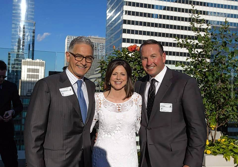 During the grand opening in 2014 of the Hyatt Centric, Karen McGuigan poses with Mark Hoplamazian, CEO of Hyatt Hotels, left, and John Murphy, vice chairman of MB Real Estate.