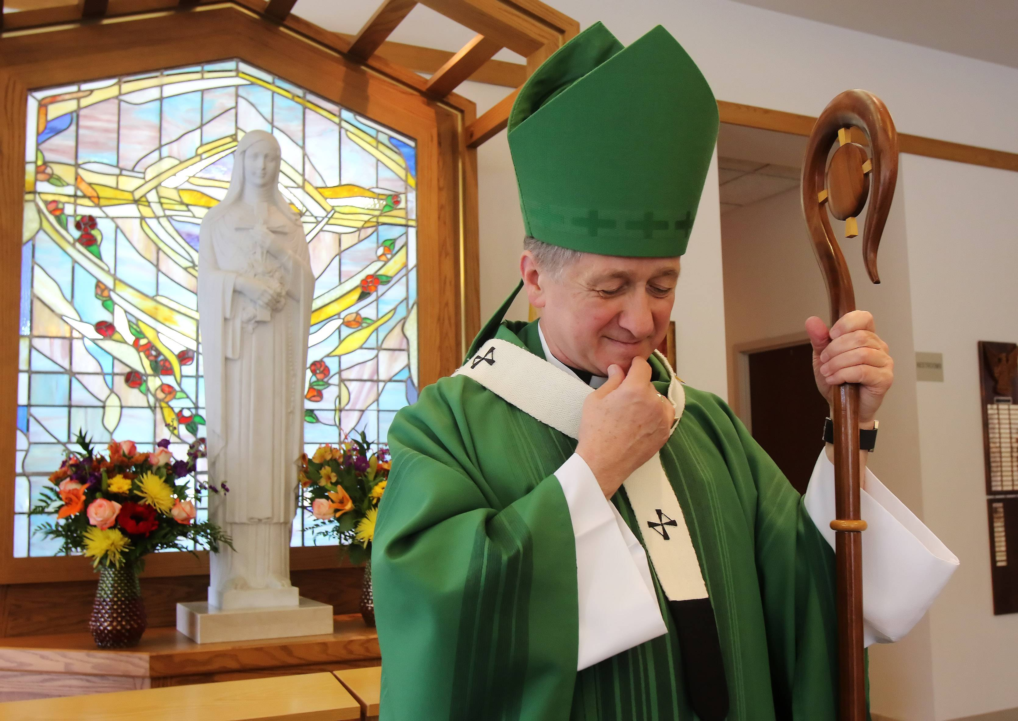 Cardinal-elect Blase Cupich prays before conducting mass at St. Theresa Parish in Palatine on Sunday. St. Theresa is celebrating its 75th anniversary.