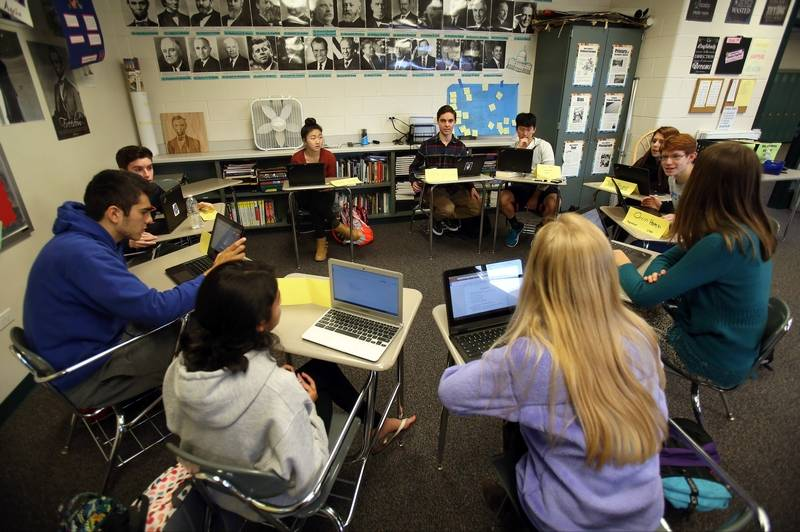Vernon Hills High School seniors work in a group during an AP Government  class. The