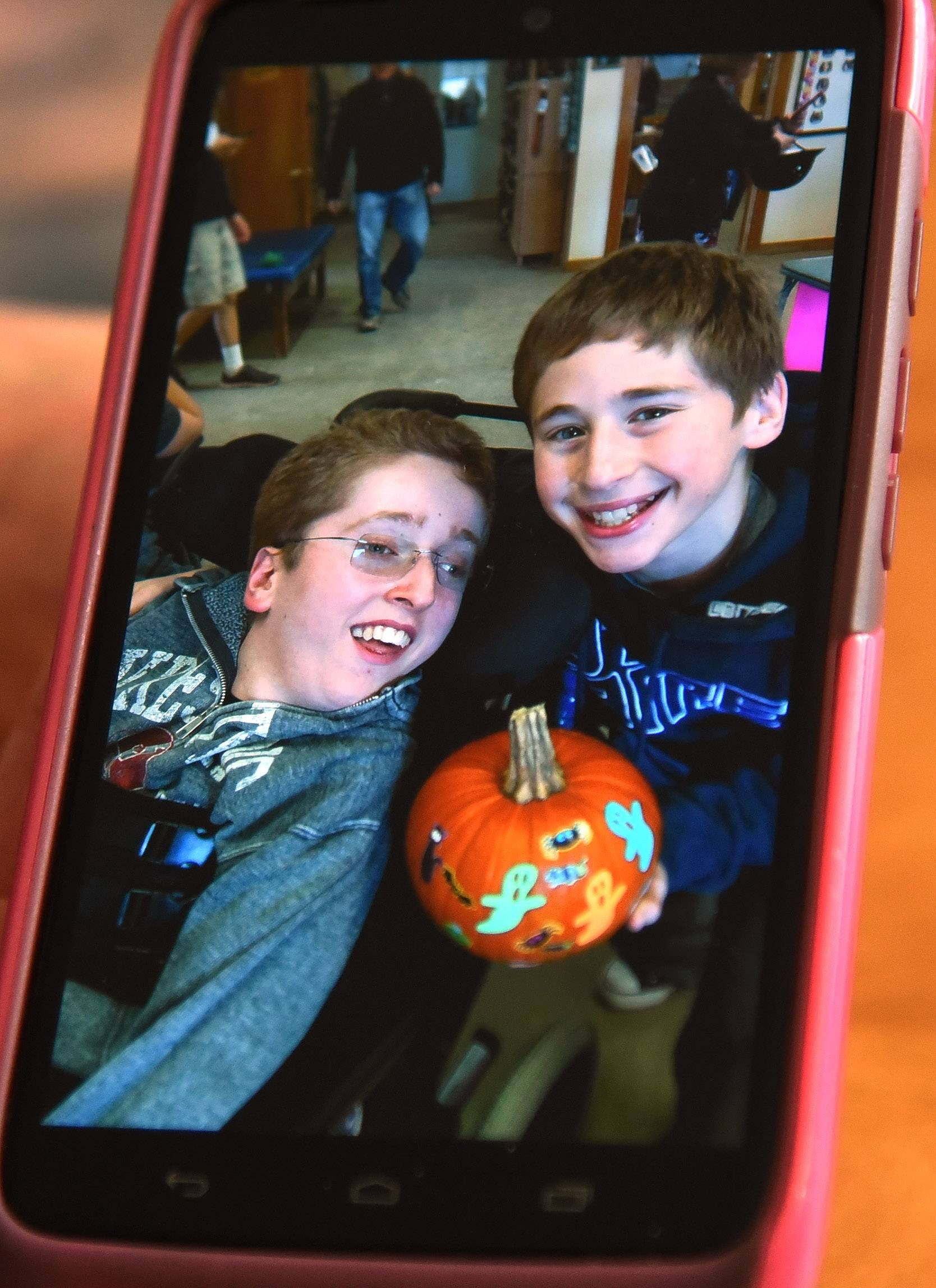 Max Randell, who has Canavan disease, with his younger brother Alex, 14, prepare for Halloween in mid-October.