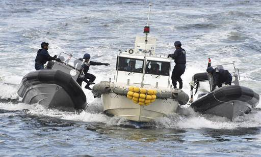 FILE - In this Thursday, Oct. 27, 2016 file photo, Japan Coast Guard security team members display tracking and capture drills by rigid-hulled inflatable boats against an unidentified ship at sea in Yokohama near Tokyo during an inspection tour by Philippine President Rodrigo Duterte. Duterte proposed joint military exercises with Japan during his visit to Tokyo, while reiterating that he will not conduct them with Americans in his presidency. Duterte made the proposal during his visit to a coast guard unit to observe an exercise from one of the patrol vessels Japan pledged to provide the Philippines to upgrade Manila's maritime security capabilities, largely in response to China's strong assertions of its South China Sea maritime claims. (Kazuhiro Nogi/Pool Photo via AP, File)