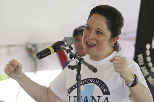 FILE - In this Aug. 18, 2016, file photo, Susan Mendoza, the Democratic candidate for Illinois state comptroller, participates in a political rally in Springfield, Ill. Mendoza faces Republican incumbent Leslie Munger, Libertarian Claire Ball and the Green Party's Tim Curtin in the general election.
