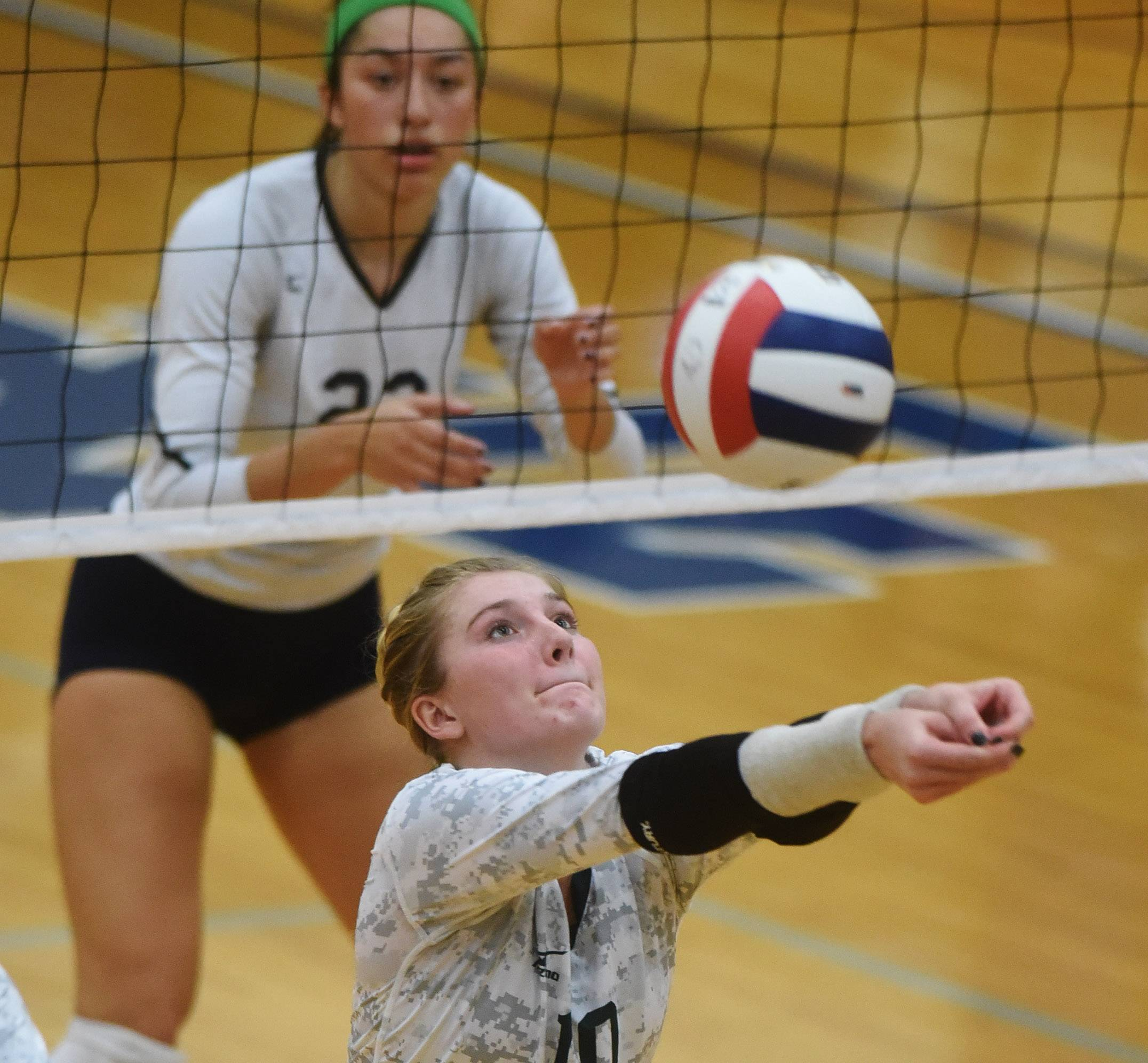 Glenbard West's Ella Ridinger gets a dig during the Class 4A Addison Trail volleyball sectional semifinal against Whitney Young Tuesday.
