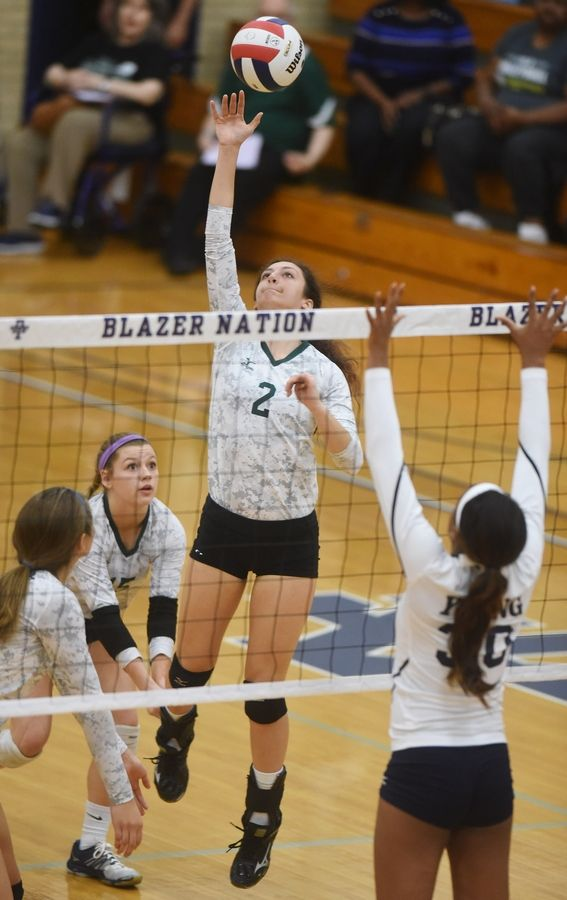 Glenbard West's Gabi Marquez leaps for a kill during the Class 4A Addison Trail volleyball sectional semifinal against Whitney Young Tuesday.
