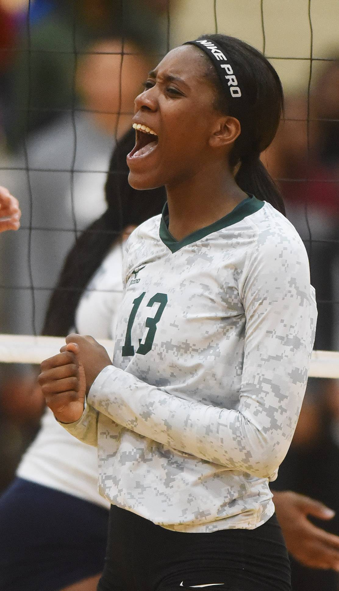 Ananda Patterson of Glenbard West celebrates a late point against Whitney Young during the Class 4A Addison Trail volleyball sectional semifinal Tuesday.