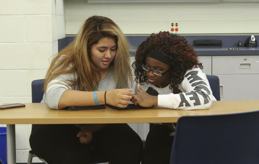 Students work out a problem together in the new AP Center at Glenbard South High School in Glen Ellyn.