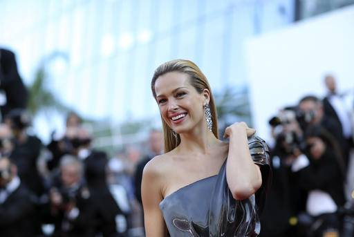 "FILE - In this May 17, 2016 file photo, model Petra Nemcova poses for photographers upon arrival at the screening of the film Julieta at the 69th international film festival, Cannes, southern France. The Czech supermodel is calling on the United Nations to help the world better prepare natural disasters. Nemcova and Tomas Alvarez-Belon whose tsunami survival story was portrayed in the film ""The Impossible,"" were at U.N. Headquarters in New York ahead of World Tsunami Awareness Day on Nov. 5, 2016."
