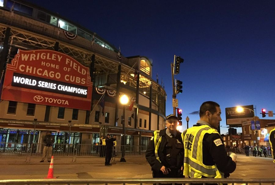 Police officers are in place at Wrigley Field in Chicago Friday morning in preparation for the Cubs victory parade.