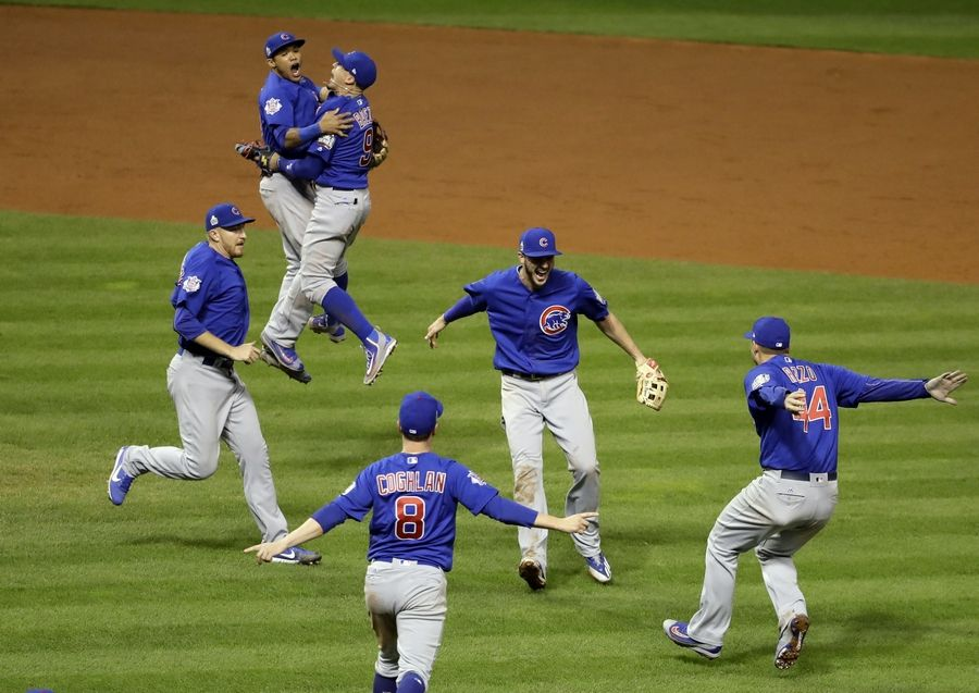 The Chicago Cubs celebrate after Game 7 of the Major League Baseball World Series against the Cleveland Indians Wednesday and a parade is planned in downtown Chicago Friday.