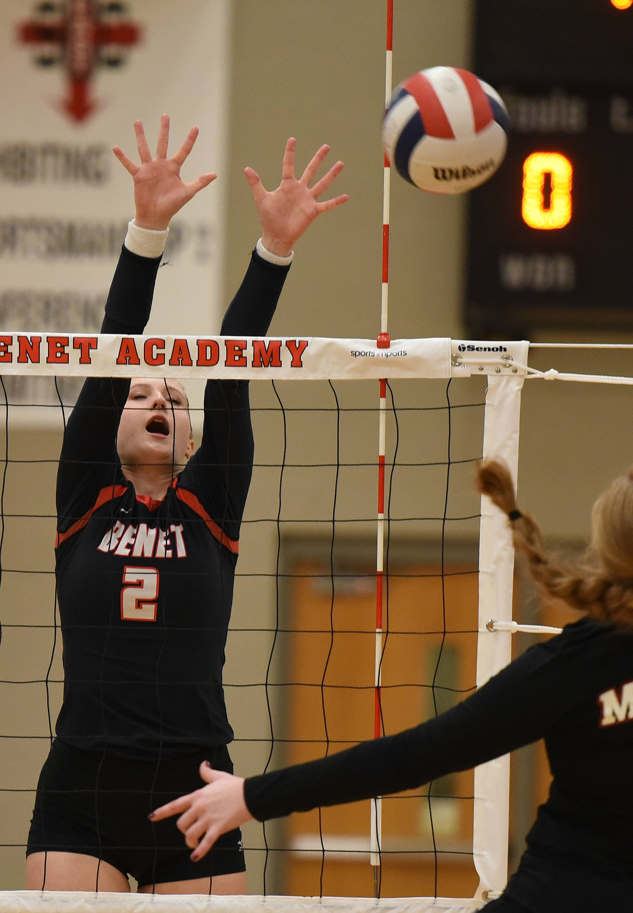 Paul Michna/pmichna@dailyherald.comBenet's Veronica Snelling (2) goes for a block during the Marist at Benet girls volleyball game Thursday.