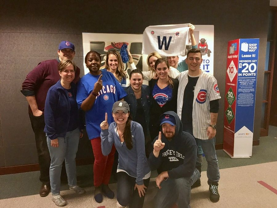 Workers at Hoffman Estates-based Sears Holdings Corp. gathered Thursday after the Cubs won the World Series. While it was business as usual, they did have the chance to wear their sports gear.