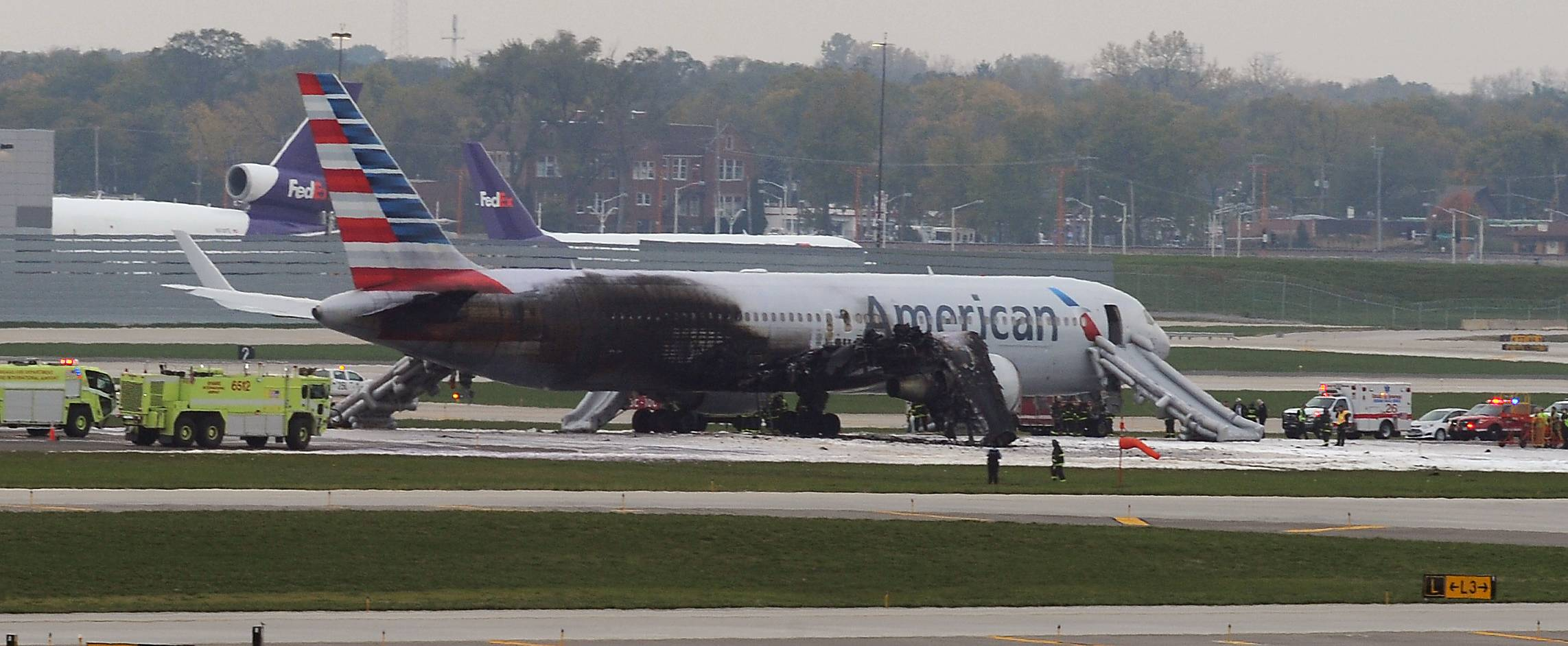 An American Airline plane reveals fire damage on Runway 28R at Chicago O'Hare International Airport.