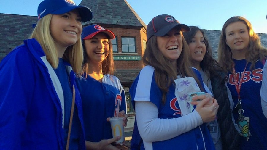 Megan Martin, left, and friends Nicole Cwik, Jillian Palmer, Marguerite Vassos and Stephanie Les gathered at the Arlington Heights Metra station Friday to take a train to the Cubs parade in Chicago.