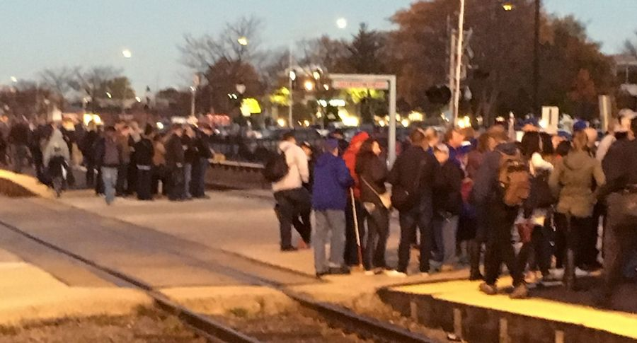 Fans pack the Arlington Heights Metra station Friday morning on their way to the Cubs rally downtown at Grant Park.