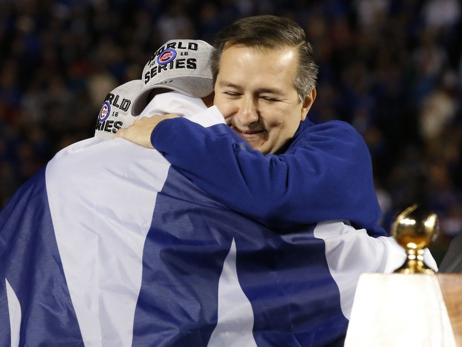 Chicago Cubs Chairman Tom Ricketts, right, celebrates with Jon Lester after Game 6 of the National League baseball championship series Los Angeles against the Los Angeles Dodgers, Saturday, Oct. 22, 2016, in Chicago. The Cubs won 5-0 to win the series and advance to the World Series against the Cleveland Indians.