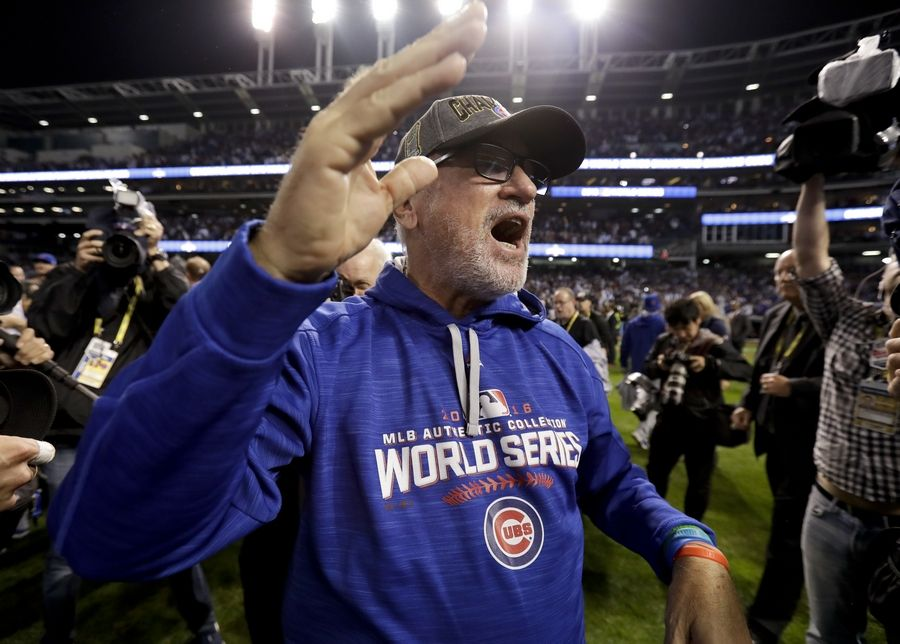 Chicago Cubs manager Joe Maddon celebrates after after Game 7 of the Major League Baseball World Series against the Cleveland Indians Thursday, Nov. 3, 2016, in Cleveland. The Cubs won 8-7 in 10 innings to win the series 4-3.