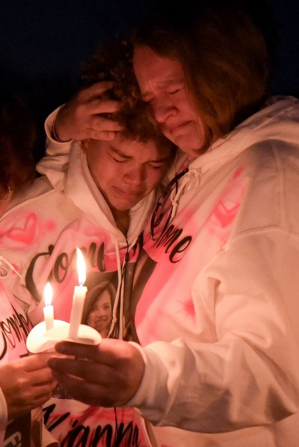 Miah Galvin and her mom, Fiona, hug and cry Sunday during a candlelight vigil at Jim Hansen Park in South Elgin. Miah's sister, Kianna Galvin, disappeared May 6.