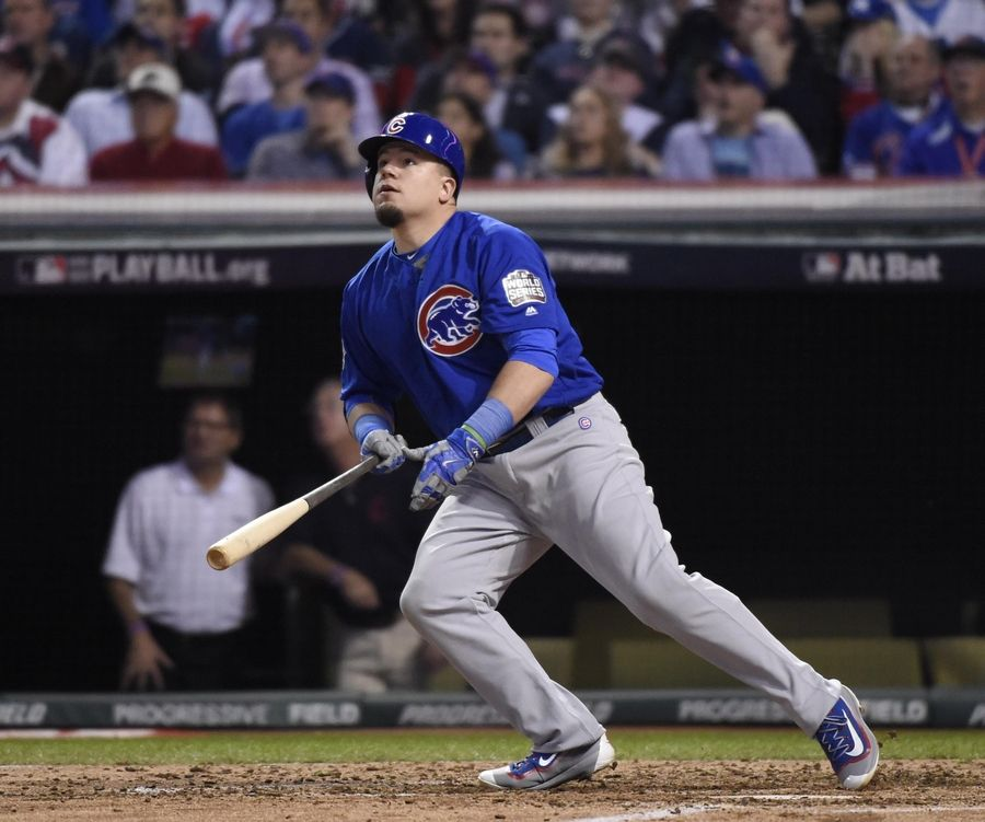 Chicago Cubs designated hitter Kyle Schwarber watches his drive in the fourth inning Tuesday in Game 6 of the World Series at Progressive Field in Cleveland.