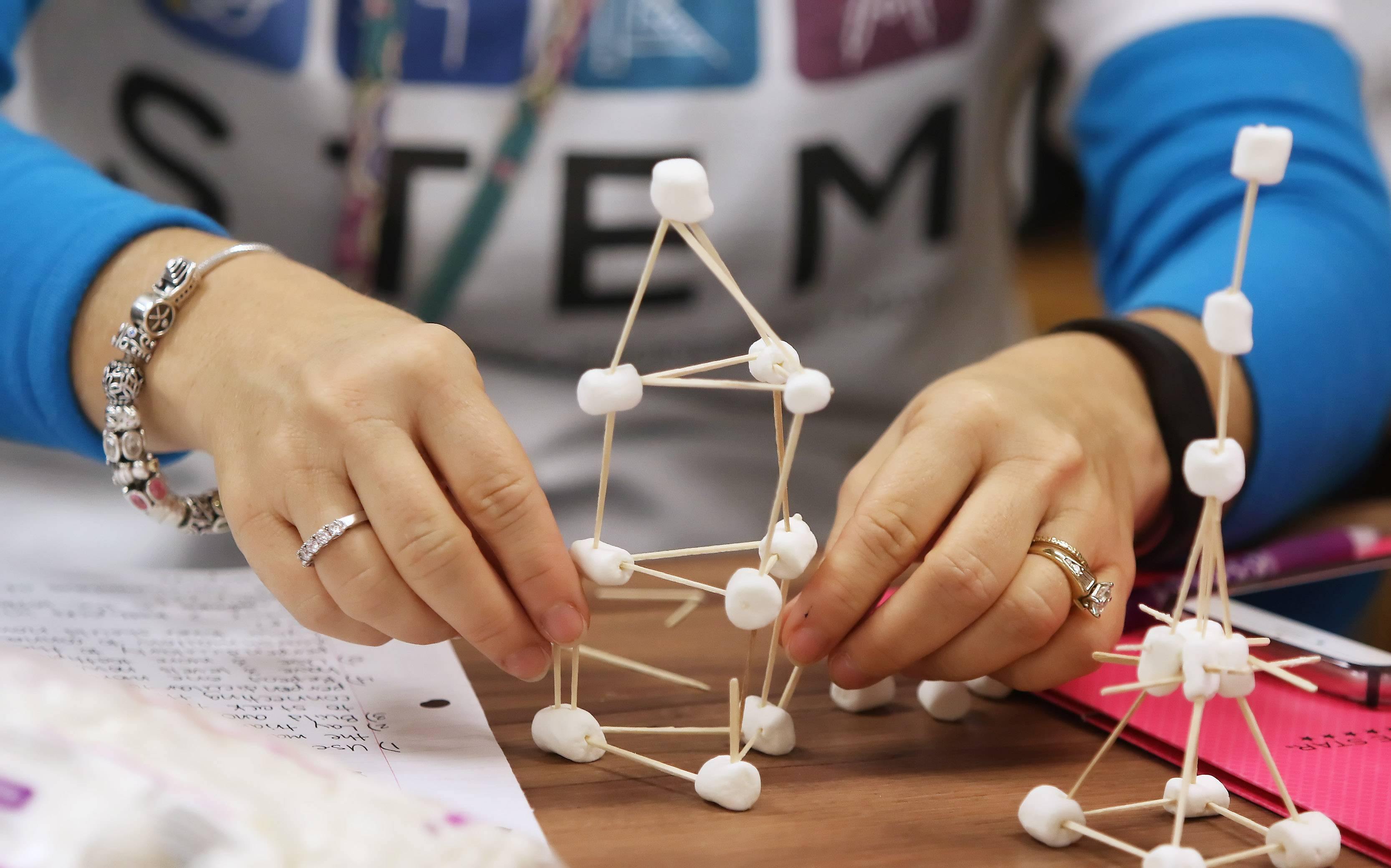 Teacher Kathleen Winkiel builds a structure using toothpicks and marshmallows during a STEM workshop for teachers Monday at Stanton Elementary School in Fox Lake. Kristin Brynteson of Northern Illinois University's STEM program instructed the teachers with hands-on training and activities.