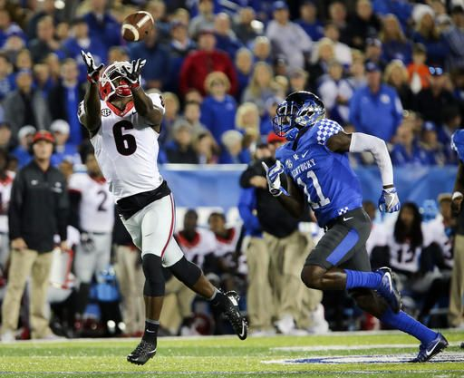 Georgia wide receiver Javon Wims (6) catches a pass in front of Kentucky cornerback J.D. Harmon for a first down in the first half of an NCAA college football game Saturday, Nov. 5, 2016, in Lexington, Ky.