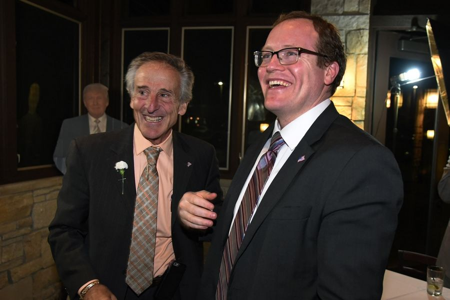 McHenry County State's Attorney candidate Patrick Kenneally, right, gathers with supporters Tuesday night in McHenry. Outgoing state's attorney Louis Bianchi, left, was on hand for the celebration.