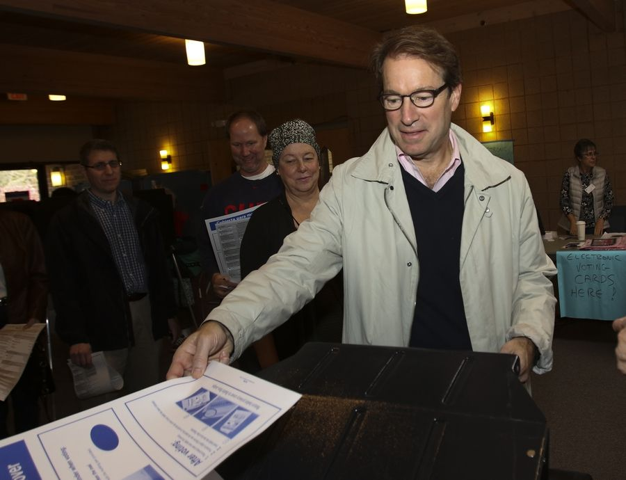Peter Roskam votes at Wellspring Alliance Church on Tuesday in Wheaton.