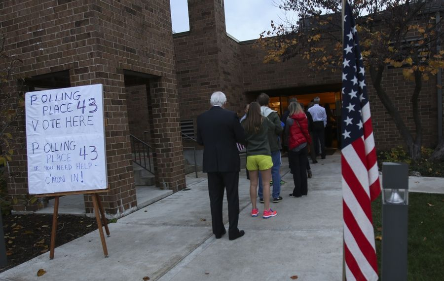 Voters line up outside Wellspring Alliance Church in Wheaton on Tuesday.
