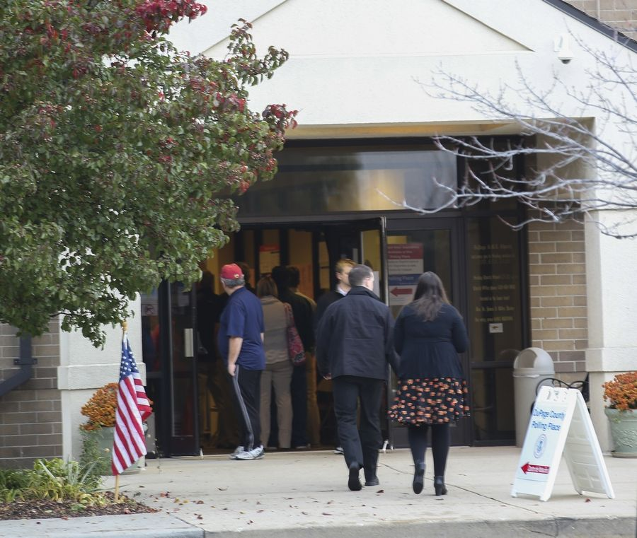 Voters head into A.M.E. Church in Lisle on Tuesday.