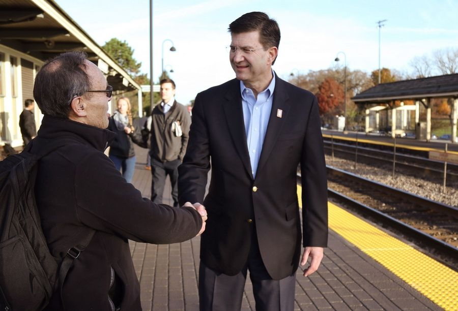 Congressman-elect Brad Schneider shakes hands with Jules Crystal of Deerfield at the Deerfield Metra station Wednesday.