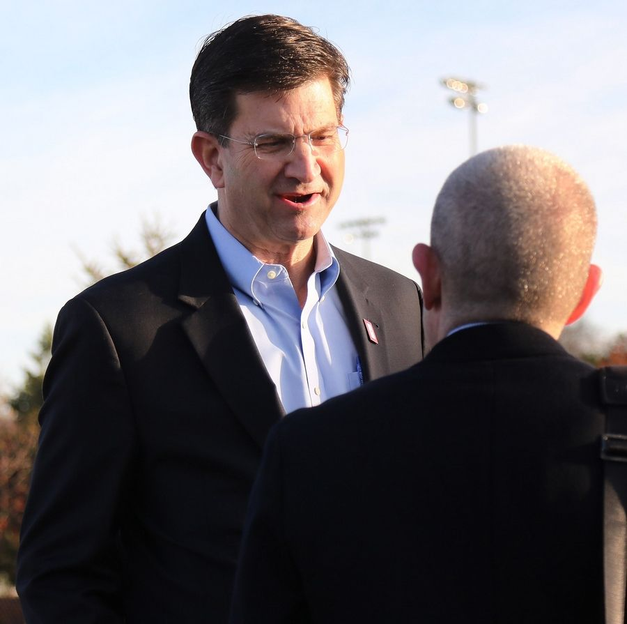 Congressman-elect Brad Schneider greets commuters at the Deerfield Metra station on Wednesday, the morning after he won back the 10th House seat now held by Republican Bob Dold.