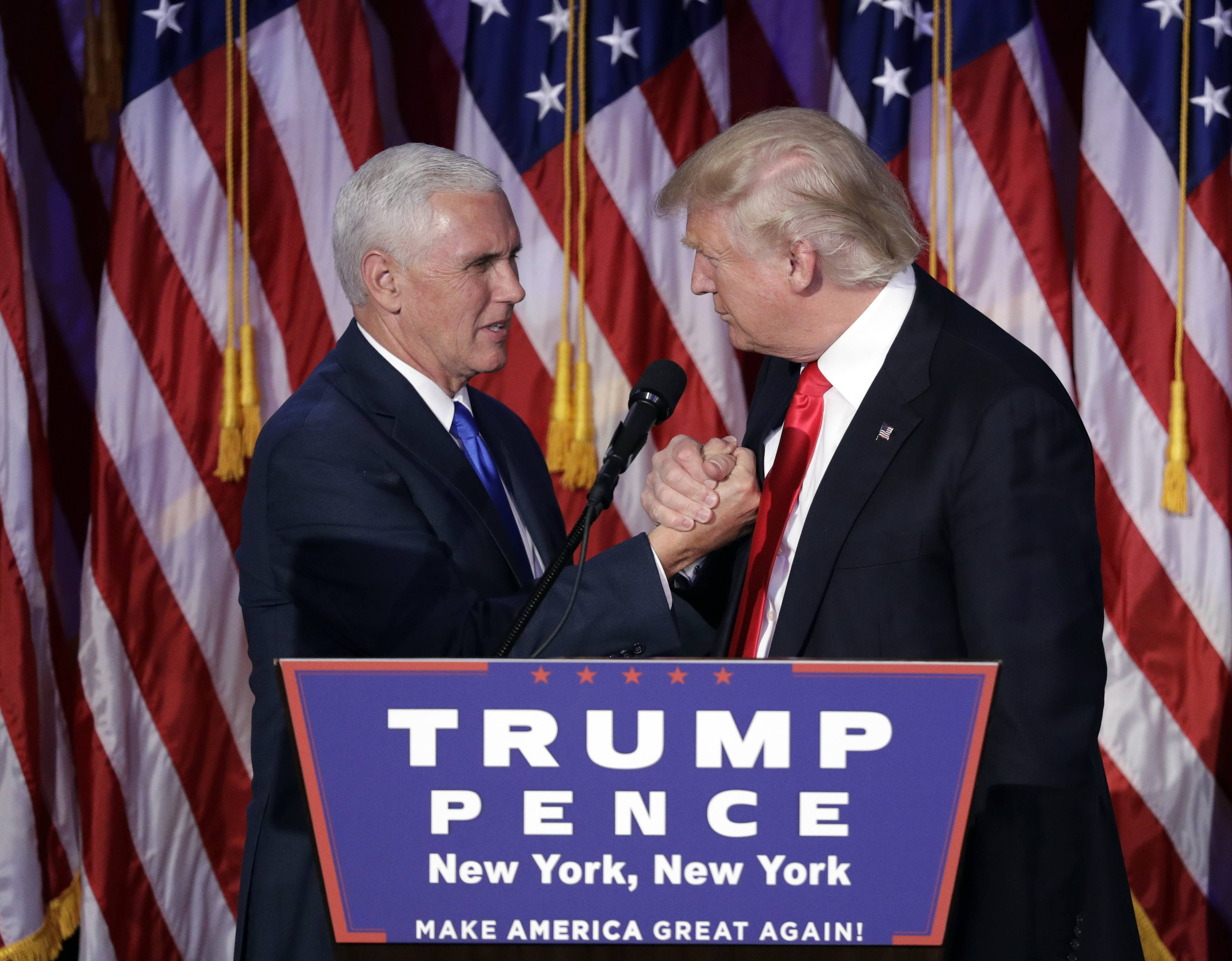 President-elect Donald Trump shakes hands with Vice President-elect Mike Pence as he gives his acceptance speech Wednesday during his Election Night rally in New York.