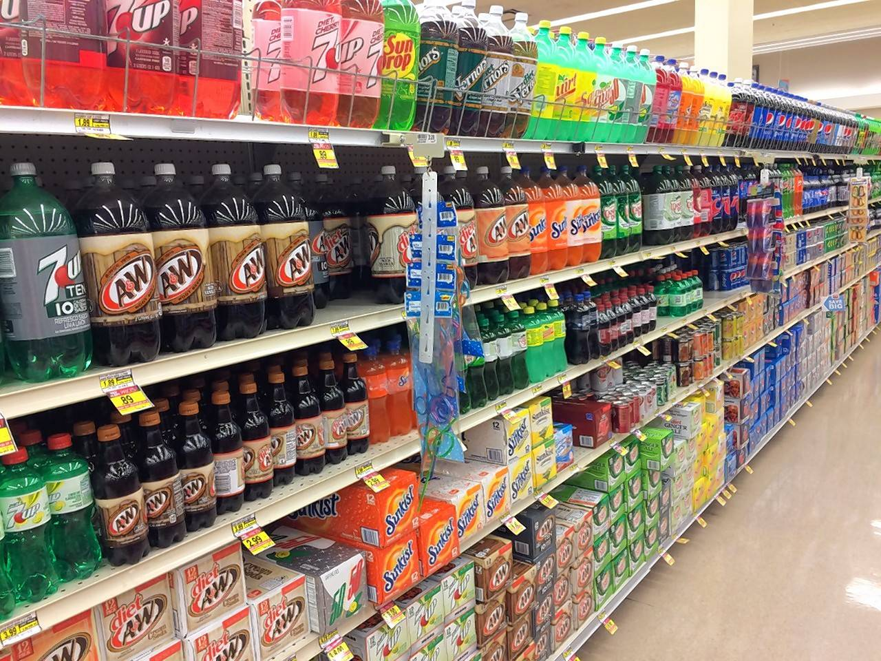 Cook County's sweetened-beverage tax of a penny per ounce will nearly double the cost of a two-liter bottle of soda.
