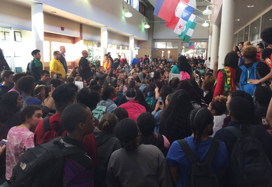 "About 150 to 200 students gather in a hallway near the library to discuss diversity and respect Thursday in response to ""White's Only"" graffiti found on a bathroom door at Warren Township High School's Almond Road campus in Gurnee."