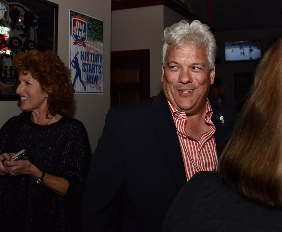 Democrat Jack Franks talks with supporters Tuesday at his victory gathering at Offsides Sports Bar and Grill in Woodstock. He beat out Republican Michael Walkup in the race for the first elected McHenry County Board chairman.