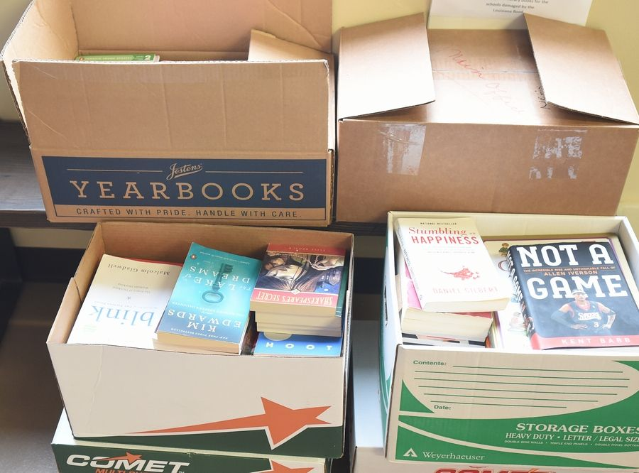 Boxes holding some of the roughly 10,000 books en route to Friends of Livingston Parish Public Schools in Louisiana from students in Naperville contain fiction, nonfiction, popular titles and classics.