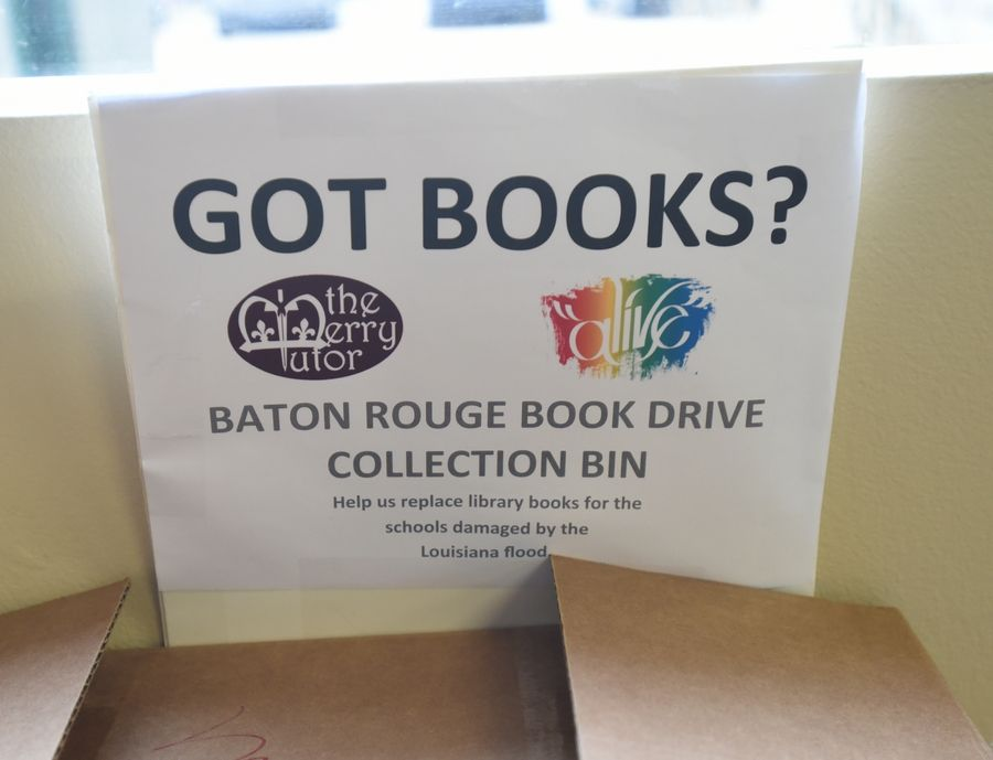A collection bin at the Alive Center, where many Naperville teens hang out after school during NaperBridge drop-in hours, helped gather roughly 10,000 books to send to flood-ravaged Louisiana.