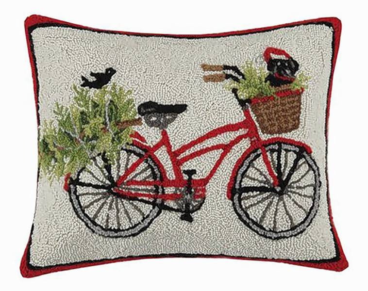 A needlepoint bike pillow helps complete the decor.