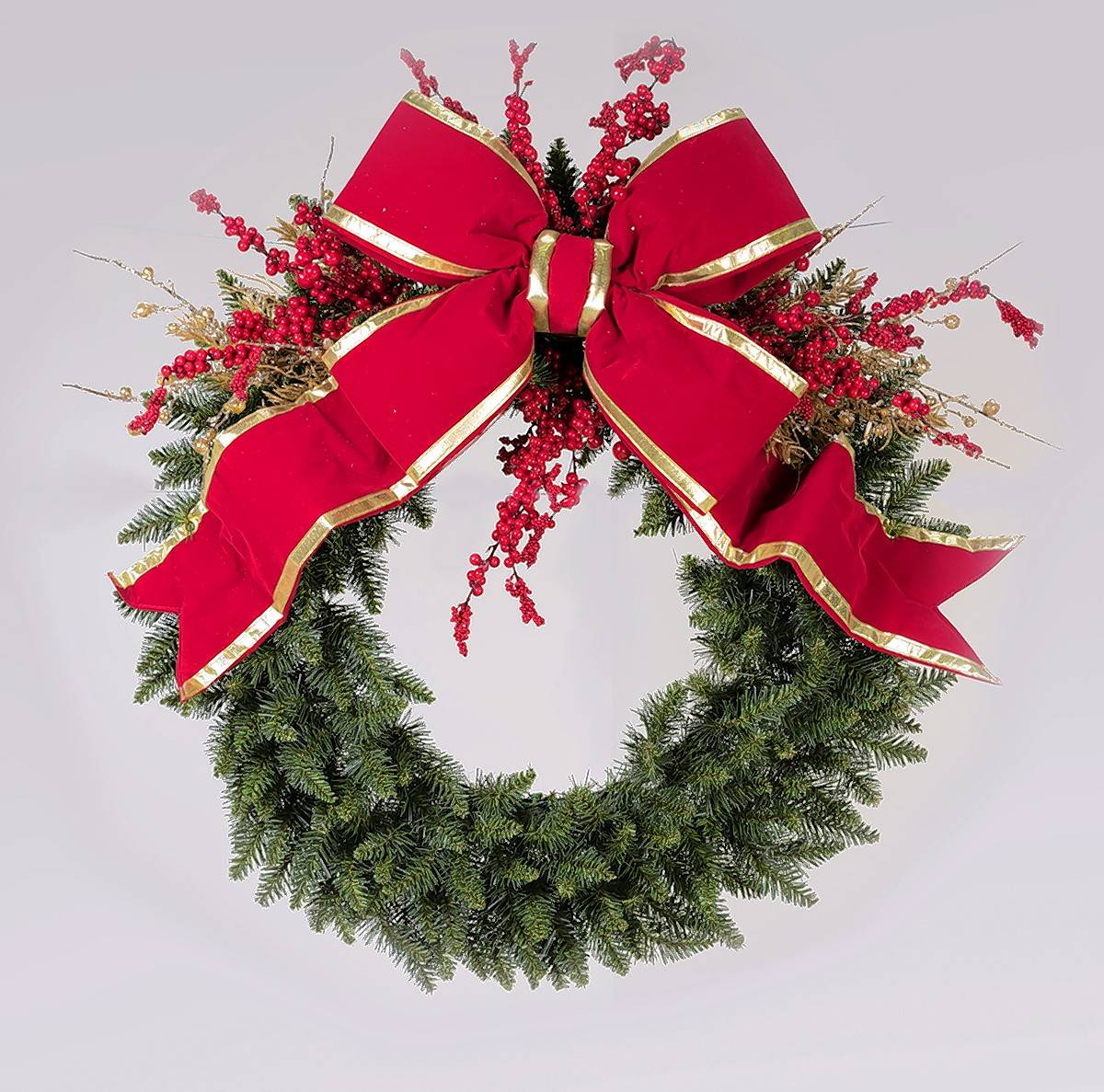 Wreaths are commonly hung over the mantel or on a door, but the wall behind the sofa is also a great spot.