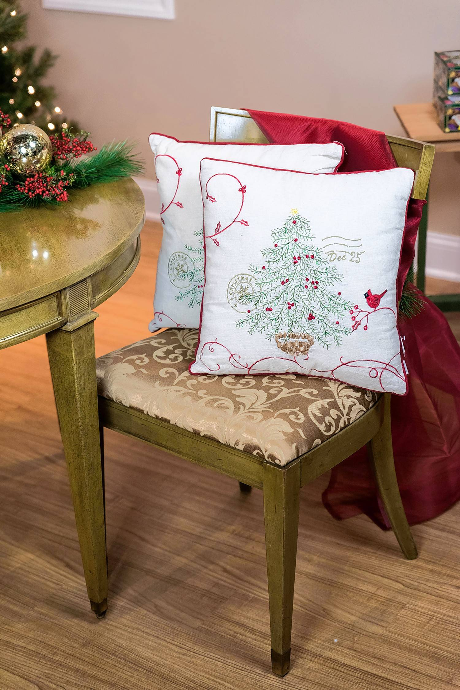 Holiday pillows spruce up dining chairs.