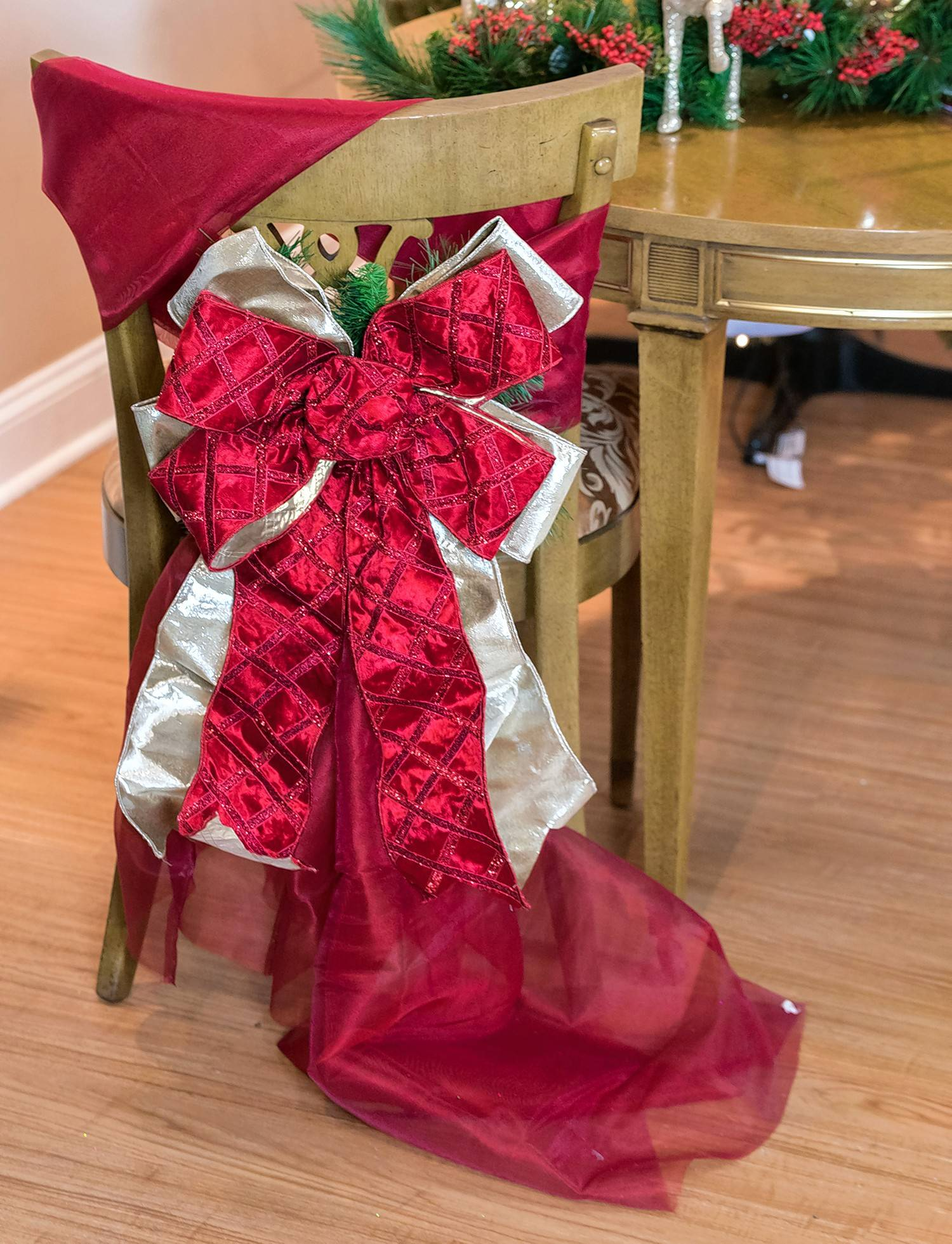 A bow tied around the chair back will take your decorations to the next level.