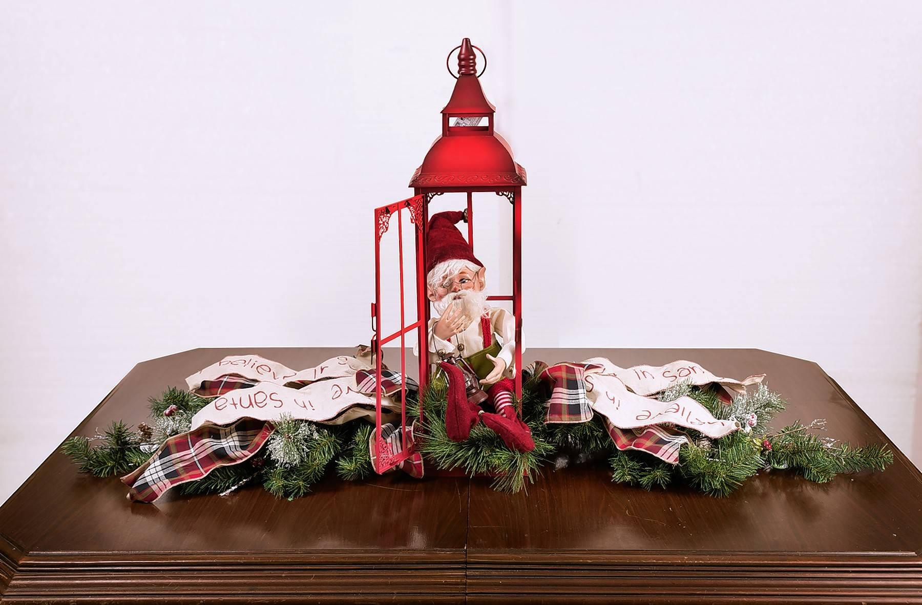 This elf in lantern vignette would be perfect for a side table.