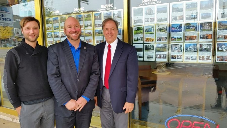 Adam Law, left, and John Law and Rob Schaid, broker/owner of RE/MAX Plaza.