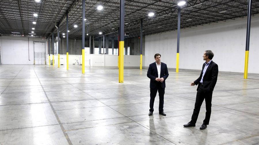 JLL's Steve Ostrowski, vice president of Industrial Real Estate Services, left, and Keith Stauber, managing director of the Midwest Industrial Services Group, stand inside a building available for lease at 340 West Crossroads in Bolingbrook.