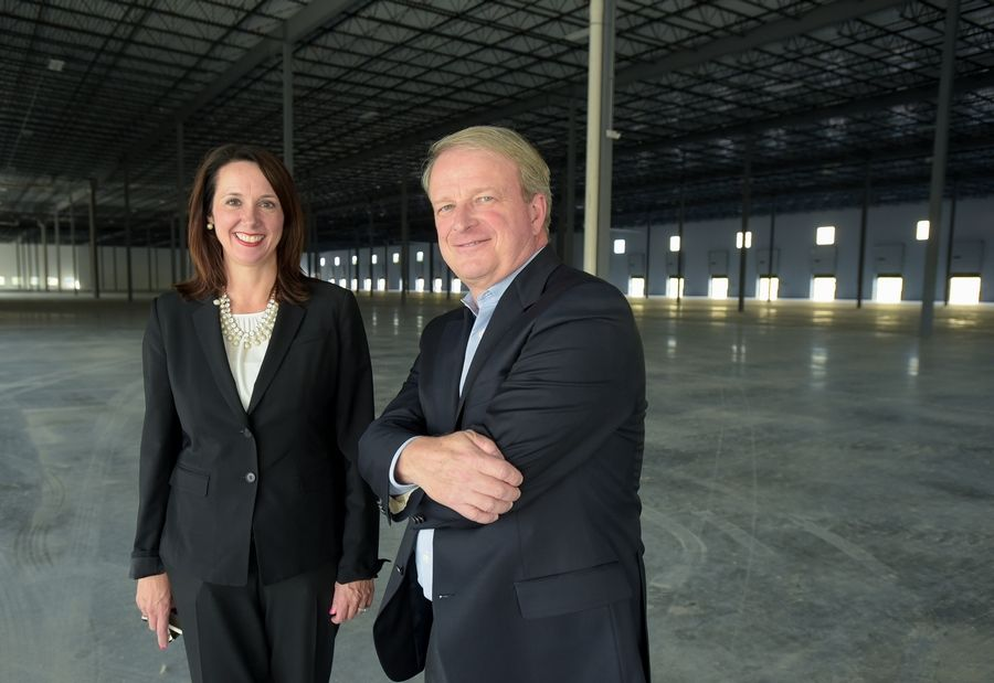 Traci Buckingham Payette, senior vice president of CBRE, and Don Schoenheider of Hillwood, stand in a Romeoville Commerce Center building.